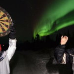 Column #509  Darts under the Northern Lights